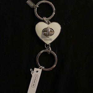 Coach enamel white heart keychain